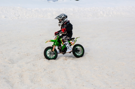 Winter Motocross competitions among children Stock Photo - 18468824