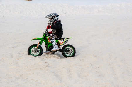 Winter Motocross competitions among children Stock Photo - 18468822