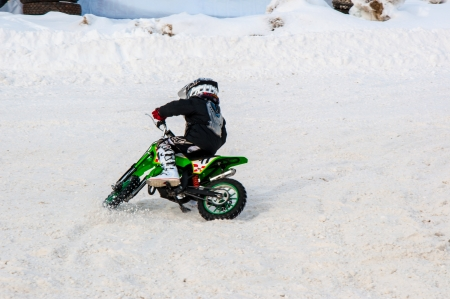 Winter Motocross competitions among children Stock Photo - 18468825