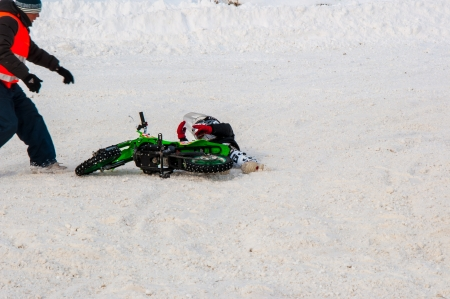 Winter Motocross competitions among children Stock Photo - 18468836