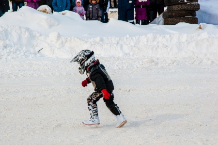 Winter Motocross competitions among children Stock Photo - 18468832