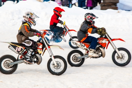 Winter Motocross competitions among children Stock Photo - 18468828