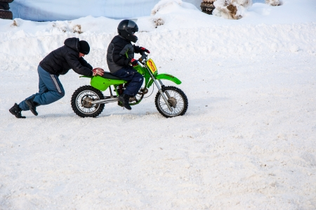 Winter Motocross competitions among children Stock Photo - 18468829
