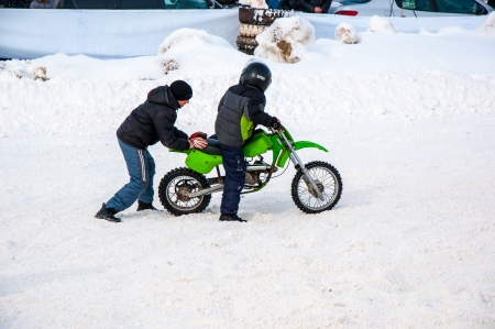 Winter Motocross competitions among children Stock Photo - 18468827