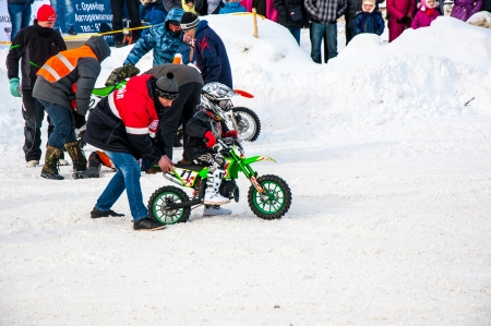 Winter Motocross competitions among children Stock Photo - 18468834