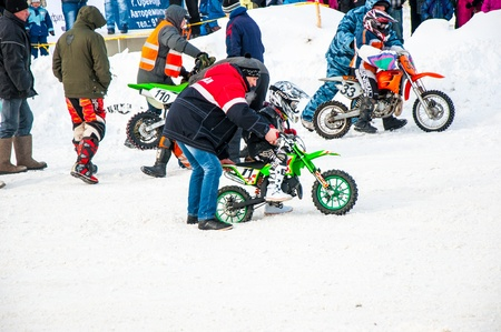 Winter Motocross competitions among children Stock Photo - 18468830