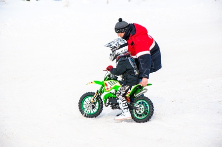 Winter Motocross competitions among children Stock Photo - 18468819