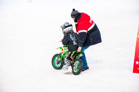 Winter Motocross competitions among children Stock Photo - 18468820