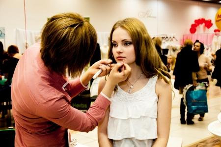 Makeup artist bring girl make-up