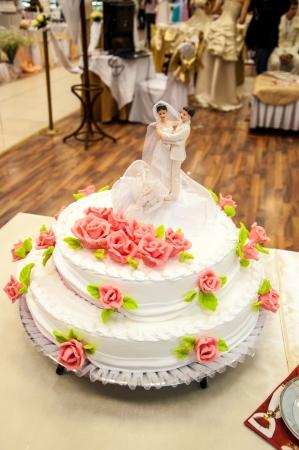 Decorating a wedding cake photo