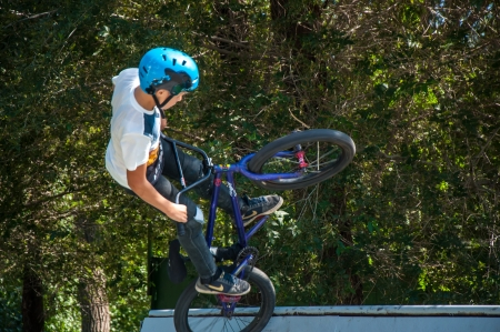 The city of Orenburg, Orenburg oblast, Russia, August 16, 2013. Workout fans of bike trial