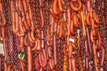 Smoked sausage, Salami, dry sausage with herbs photo