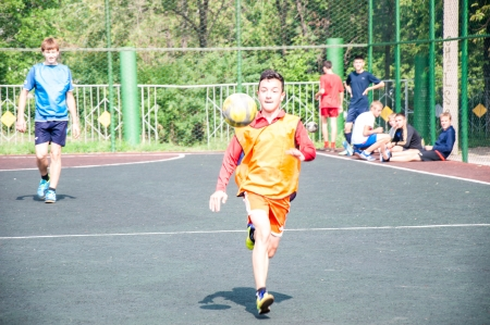 feast day: The city of Orenburg, Orenburg oblast, Russia, August 10, 2013.  The feast day of the athlete. Tournament on mini-football among school teams.