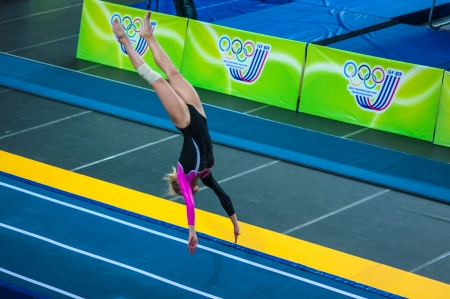 The city of Orenburg, Orenburg oblast, Russia, August 24, 2013. Russian Championship on the jumps on trampoline. The girl on the acrobatic track