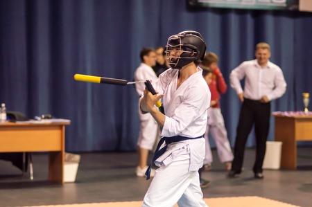 sensei: ORENBURG, ORENBURG region, RUSSIA, 11 may, 2014 year. Kobudo competition men with nunchaku. Kobudo east martial art Editorial