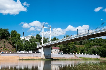 Pedestrian bridge across the river Ural connecting Europe and Asia photo