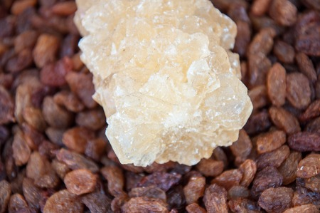 Oriental sweetness of crystal sugar or navat environmentally-friendly product made by hand according to old recipes without chemical additives Stock Photo