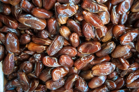 dactylifera: Dates the edible fruit of the date palm, especially species of Phoenix dactylifera Stock Photo