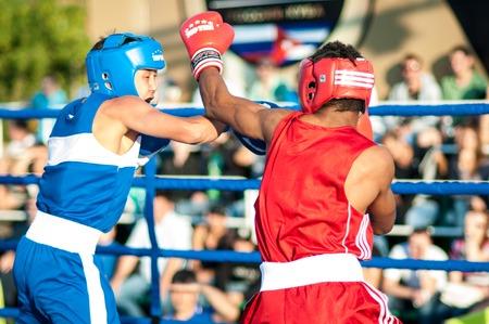 ORENBURG, ORENBURG region, RUSSIA, 25 July, 2014 year. Match meeting Russia on Boxing, Cuba. A boxing match Javier Ibanez, Cuba and Malik Bajtleuov, Russia. Defeated Javier Ibanez