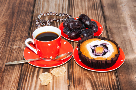 unrefined: Coffee Cup dates cake and crystal sugar navat Stock Photo