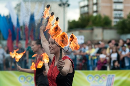ORENBURG, ORENBURG region, RUSSIA, 25 July, 2014 year. The girls performed a dance with burning torches