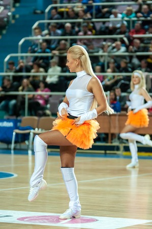combines: ORENBURG, ORENBURG region, RUSSIA, 21 October, 2014 year. Cheerleading is a sport that combines elements of show and entertainment sports. Girl cheerleading Editorial