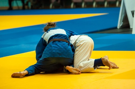 weaker: ORENBURG, ORENBURG region, RUSSIA, 29 October, 2014 year. All-Russian Judo tournament in memory of Viktor Chernomyrdin. Girl in Judo