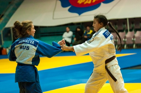 weaker: ORENBURG, ORENBURG region, RUSSIA, 29 October, 2014 year. All-Russian Judo tournament in memory of Viktor Chernomyrdin. Girl in Judo
