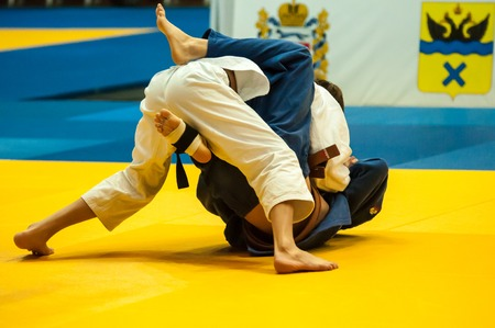 weaker: ORENBURG, ORENBURG region, RUSSIA, 29 October, 2014 year. All-Russian Judo tournament in memory of Viktor Chernomyrdin. Young men in Judo