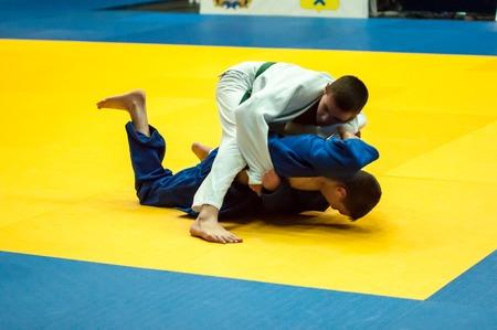 weaker: ORENBURG, ORENBURG region, RUSSIA, 29 October, 2014 year. All-Russian Judo tournament in memory of Viktor Chernomyrdin. Young men in Judo