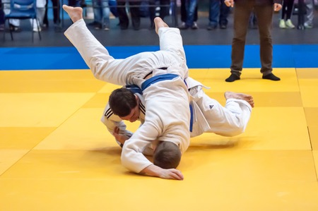 fling: ORENBURG, ORENBURG region, RUSSIA, 29 November, 2014 year. Judo Championship among juniors and girls. Two judoka