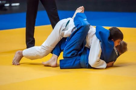fling: ORENBURG - 29 November: Championship among juniors and girls. Struggling boys 29 November 2014 in ORENBURG, ORENBURG region, RUSSIA.