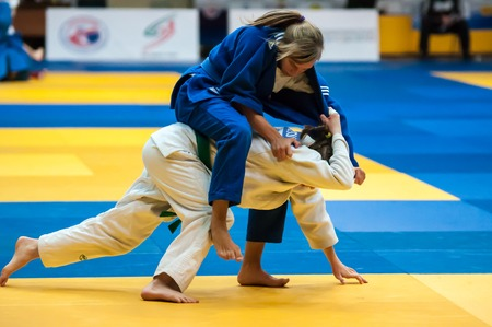 weaker: ORENBURG - 29 October: All-Russian Judo tournament in memory of Viktor Chernomyrdin. Girls in Judo competitions 29 October 2014 in ORENBURG, ORENBURG region, RUSSIA Editorial