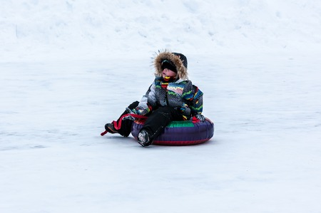 ORENBURG - 18 January: Baby winter sledding on the Ural River   18 January 2015 year in ORENBURG, ORENBURG region, RUSSIA.