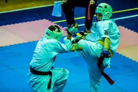 karateka: ORENBURG, ORENBURG region, RUSSIA, 16 November, 2014 year. Open karate tournament kiokusinkaj. Two karateka. Editorial