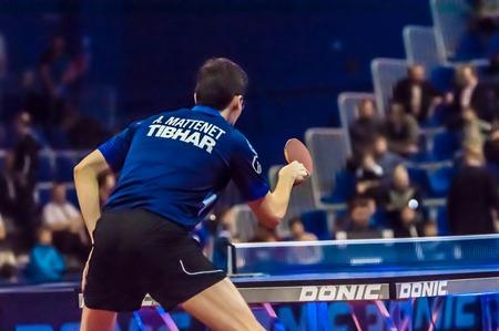 tabletennis: Orenburg, Orenburg region, Russia - 23 January  2015: Game European champions  League quarterfinal match on table tennis among mens teams the torch of Gazprom (Orenburg) -  Saarbruecken ( Germany)