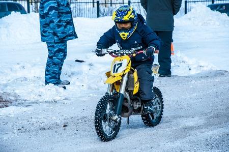 bridging: Orenburg, Orenburg region, Russia - 10 March 2013: Juniors compete in winter Motocross