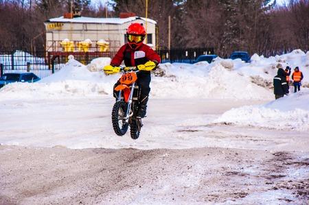 bridging: Orenburg, Orenburg region, Russia - 10 March 2013: Juniors compete in winter Motocross. Editorial