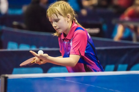 strongest: ORENBURG, ORENBURG region, RUSSIA - 5 February 2015: Girl playing table tennis at the tournament strongest sportsmen of Russia TOP – 12 in table tennis.