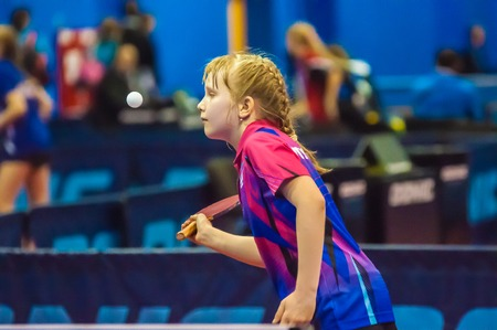 the strongest: ORENBURG, ORENBURG region, RUSSIA - 5 February 2015: Girl playing table tennis at the tournament strongest sportsmen of Russia TOP – 12 in table tennis.