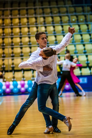 Orenburg, Orenburg region, Russia - 3 October 2014: He and she whirl in dance on Open Championship city of dancesport