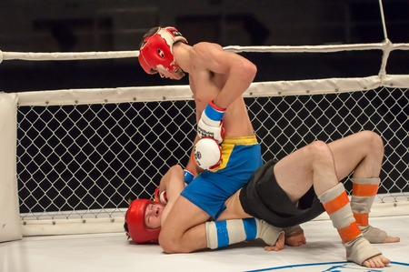 greco roman  roman: ORENBURG, ORENBURG region, RUSSIA - 21 February 2015: Match two MMA fighters on the open cup of Orenburg region mixed martial martial art (MMA). Editorial