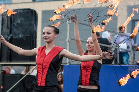Orenburg, Orenburg region, Russia - 25.07.2014: The girls performed a dance with burning torches during youth meetings in the boxing tournament between Russia and Cuba