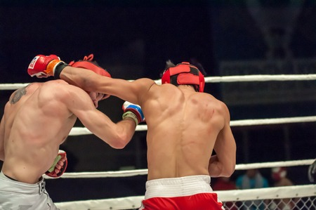 Orenburg, Russia - 21.02.2015: Fight in mixed martial arts fighters on the open cup of Orenburg region mixed martial art (MMA) or Fights without rules