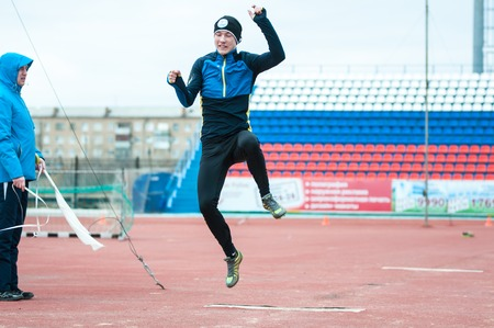 vocational: Orenburg, Russia - 24 April 2015: Men compete in long jump on the sports contest students of institutions of secondary vocational education Youth of the Orenburga Editorial