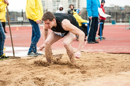 secondary education: Orenburg, Russia - 24 April 2015: Men compete in long jump on the sports contest students of institutions of secondary vocational education Youth of the Orenburga Editorial