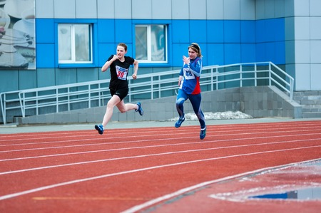 secondary education: Orenburg, Russia - 24 April 2015: Girls compete in the run on the sports contest students of institutions of secondary vocational education Youth of the Orenburga