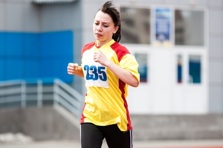 vocational: Orenburg, Russia - 24 April 2015: Girls compete in the run on the sports contest students of institutions of secondary vocational education Youth of the Orenburga