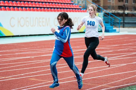 institutions: Orenburg, Russia - 24 April 2015: Girls compete in the run on the sports contest students of institutions of secondary vocational education Youth of the Orenburga