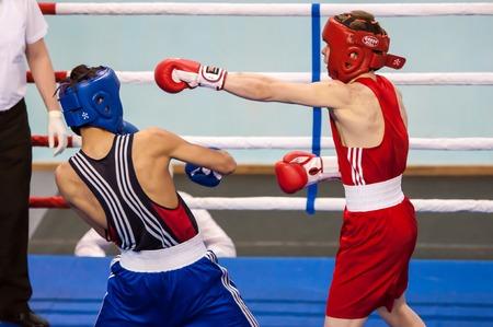 militia: Orenburg, Russia - 29 April 2015: Fight boxers on All-Russian tournament in boxing among Juniors 1997-98 born in memory of Lieutenant Colonel of militia who died tragically A.T. Kayumova Editorial